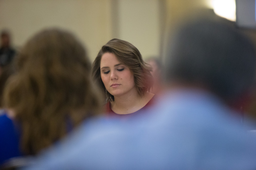 Katie Meek prays during the invocation at The Spring 2015 Student Publications End of the Year Dinner at the Augenstein Alumni Center on May 8th, 2014.
