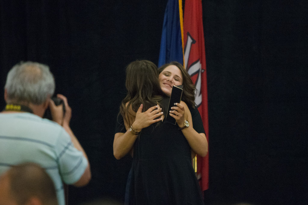 Katie Meek, the outgoing editor of the Talisman, congratulates Naomi Driessnack, one of the two incoming editors during the Spring 2015 Student Publications End of the Year Dinner at the Augenstein Alumni Center on May 8th, 2014.