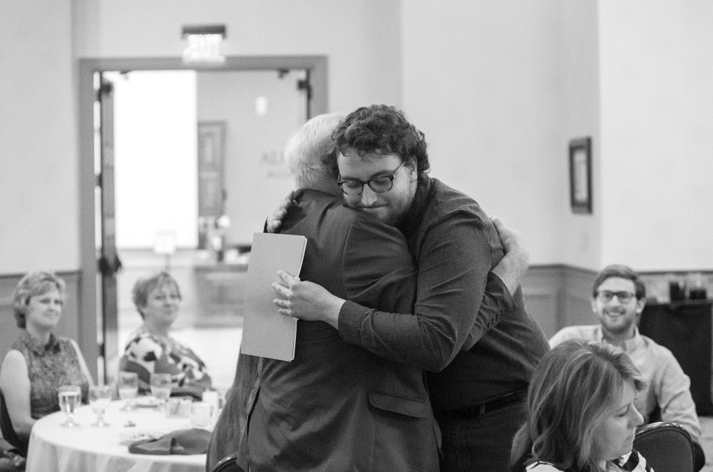 Cameron Love hugs Mr. A., after being given a scholarship  in his name during the Spring 2015 Student Publications End of the Year Dinner at the Augenstein Alumni Center on May 8th, 2014.